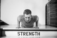 Black And White Shot Of Man In Gym Doing Press-Ups Royalty Free Stock Images