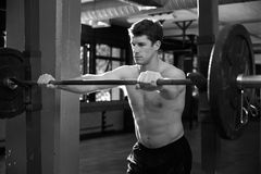 Black And White Shot Of Man Preparing To Lift Weights Stock Images