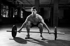 Black And White Shot Of Man Preparing To Lift Weights Royalty Free Stock Photography