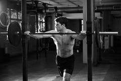 Black And White Shot Of Man Preparing To Lift Weights Stock Photo