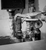 Black and white shot of man repairing heating system Stock Photos