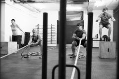 Black And White Shot Of People In Gym Circuit Training Stock Images