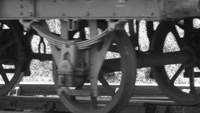 Black and white shot of steam train carriages on track, wheels only 4K. Steam train carriage wheels on track with sound of steam train 4K blck and white stock video