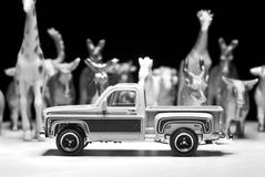 Black and white shot of toy pick-up on the background of toy animals Stock Image