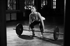 Black And White Shot Of Woman Preparing to Lift Weights Stock Photo
