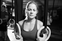 Black And White Shot Of Woman Using Gymnastic Rings In Gym Royalty Free Stock Image