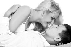 Black and white shot of young couple. In love kissing Royalty Free Stock Photography