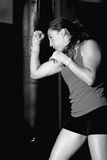 Black and white side view of female boxer fighting Stock Photo