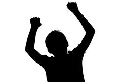 Black and white silhouette of a boy cheering Stock Image