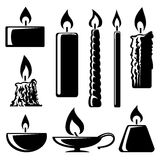 Black and white silhouette burning candles. Set of black and white silhouette burning candles in different shapes with a spiral  conical  taper  cylindrical and Royalty Free Stock Photos