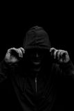 Black and white Silhouette of a hooded man, isolated on black background. Black and white Silhouette of a hooded man, isolated on black background Royalty Free Stock Photos