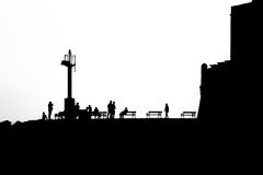 Black and white silhouette of people late afternoon Royalty Free Stock Image