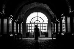 Black and white silhouette of a woman visiting a museum Royalty Free Stock Image