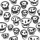 Black on White Skulls Pattern. Vector seamless pattern with calligraphy hand drawn Halloween skulls. White on black. Clipping paths included Royalty Free Stock Photos