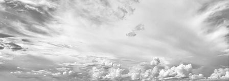 Black and white sky background with tiny clouds and cityscape on Royalty Free Stock Photo