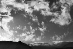 Black and white sky with clouds and mountains in evening Royalty Free Stock Photos
