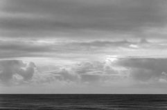 Black and white sky and sea Stock Photos