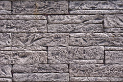 Black and white slabs imitation stone on wall Stock Image
