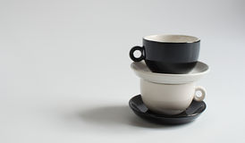 Black and white small cups Stock Images