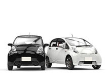 Black and white small ecomonic electric cars side by side Stock Photos
