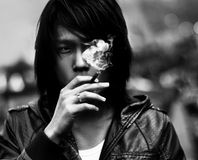 Black and white smoking asian man portrat Stock Image