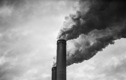 Black and White of smoking smokestacks Stock Photo