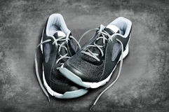 Black-and-white sneakers against a dark background Royalty Free Stock Image