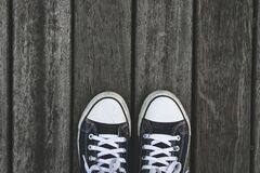 Black and White Sneakers on Grey Wooden Wood Stock Photo