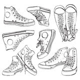 Black and white sneakers set. Vector hand drawn illustration of sneakers isolated on white Royalty Free Stock Photos