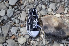 Black and white sneakers on stones. Sport shoes. Black and white sneakers on stones. Sport shoes Stock Photography