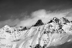 Black and white snow avalanches mountainside in clouds Royalty Free Stock Photography