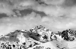 Black and white snow slope and winter sunlight mountains in clou Royalty Free Stock Image