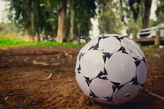Black and white soccer ball on brown sand.  Royalty Free Stock Images