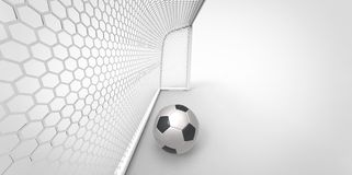A black and white soccer ball football and a goal post Royalty Free Stock Image