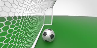 A black and white soccer ball football and a goal post on a green field like grass Stock Photography