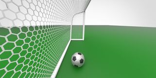 A black and white soccer ball football and a goal post on a green field like grass Stock Photos