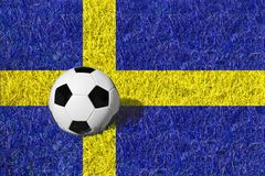 Soccer ball or football ball on blue / yellow field, national flag of Sweden Stock Image