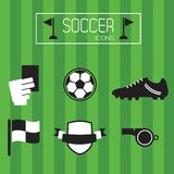 Black and white soccer icons set on green stripe background. Abstract black and white soccer icons set on green stripe soccer field background Royalty Free Stock Image