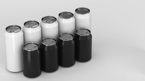 Black and white soda cans standing in two raws on white background. Big and small black and white soda cans standing in two raws on white background. Beverage Royalty Free Stock Photo