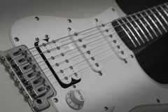 Black white solo electric lead guitar, rock music concept royalty free stock photo