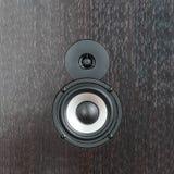 Black and white speaker on dark wooden background stock photos