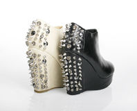 Black and White Spiked Platform Shoes. Black and White Spiked Platform Wedges on a white background stock image