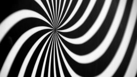 Black and White Spiral Spinning Left Defocused. Video background for a transition or luma key stock video footage