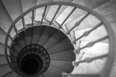 Black and white spiral staircase royalty free stock images