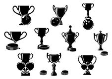 Black and white sports trophies. Black and white silhouette sports trophies for bowling with a bowling, ice hockey with a puck and tables tennis with crossed Royalty Free Stock Photo