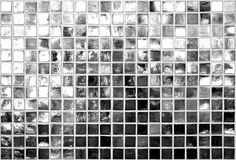Black and White Squares Background. A reflecting black and white tiled wall Royalty Free Stock Images
