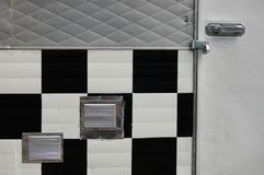 B&W Squares on Locked Portland, Oregon Food Cart Door. These are black and white squares on a locked food cart door in Portland, Oregon stock photography