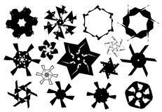 Black and white stars and snowflakes shapes Royalty Free Stock Photos
