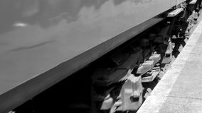 Black and white steam train close up of wheels moving on track 4K. B stock footage