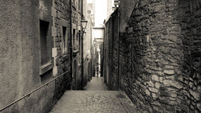 Black and white stone alley. Beside Royal miles, Edinburgh, Scotland Stock Images